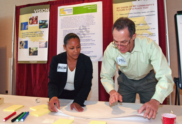 "[Hurricane Katrina/Hurricane Rita] Lake Charles, LA  January 21, 2006 - Angelique Dumas and Paul Caouette, Calcasieu Parish residents who were affected by Hurricane Rita, volunteered to work for ""Louisiana Speaks,"" a program which allows Louisians to suggest ways to rebuild and improve their state.  There were 31 Open Houses today in 24 Louisiana Parishes.  Photo by Greg Henshall / FEMA"