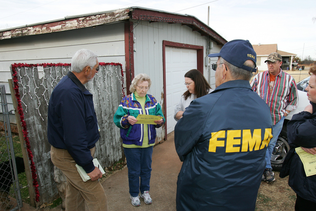 [Severe Wildfire Threat] Mustang, OK, January 21, 2006 -- FEMA Community Relations Specialists Sam Garcia and Bob Noltensmeyer and Oklahoma Emergency Manager Michelann Ooten talk with Clara Bailey and Carol and Chris Thomas about assistance available to those affected by the recent wildfires.  Bob McMillan/ FEMA Photo