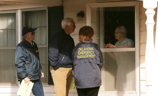[Severe Wildfire Threat] Mustang, OK, January 21, 2006 -- FEMA Community Relations Specialists Sam Garcia and Bob Noltensmeyer and Oklahoma Emergency Manager Michelann Ooten talk with an elderly lady about assistance available to those affected by the recent wildfires.  Bob McMillan/ FEMA Photo