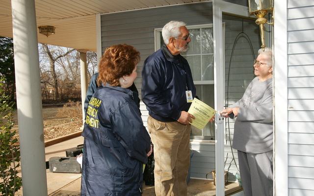 [Severe Wildfire Threat] Mustang, OK, January 21, 2006 -- FEMA Community Relations Specialists Sam Garcia and Bob Noltensmeyer and Oklahoma Emergency Manager Michelann Ooten talk with Eula Jane Holaday about assistance available to those affected by the recent wildfires.  Bob McMillan/ FEMA Photo