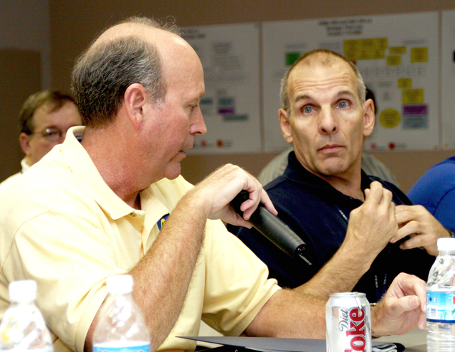 [Hurricane Katrina] Baton Rouge, LA, January 24, 2006 - State Coordinating Officer Jeff Smith (L) and Federal Coordinating Officer Scott Wells (R) present updates on recovery efforts regarding Hurricanes Katrina and Rita during a Louisiana congressional staff briefing at the Joint Field Office in Baton Rouge.  Robert Kaufmann/FEMA
