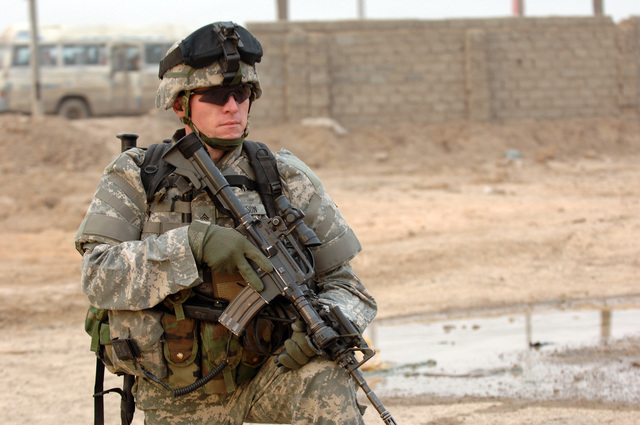 SGT. Michael Goodson from A battery, 4th Battalion 320th Field Artillery Regiment, 101st Division provides security during Operation Ten Bears in Zafaraniyah, Baghdad on January 23, 2006. Operation Ten Bears was a sweep in search for possible weapons caches. The 101st Division is currently deployed in Iraq supporting Operation Iraqi Freedom.(U.S. Army photo by SPECIALIST Teddy Wade) (Released)