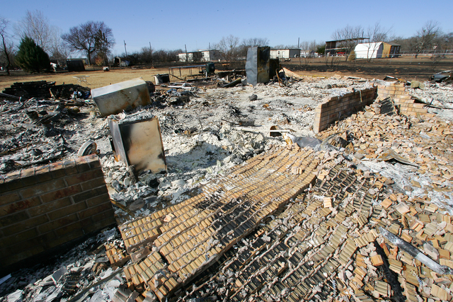 [Extreme Wildfire Threat] Canyon Creek, TX, January 24, 2006 -- Brick framed houses were totally burned by the wind driven fire.  Bob McMillan/ FEMA Photo