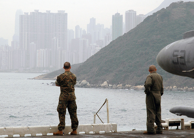 Onboard the US Navy (USN) Amphibious Assault Ship, USS TARAWA (LHA 1), US Marine Corps (USMC) Marines observes the sites of Hong Kong, while the ship prepares to make a port call at Hong Kong Harbor. The TARAWA is the flagship for Expeditionary Strike Group 1 (ESG-1), currently conducting Maritime Security Operations in the Western Pacific in support of Operation IRAQI FREEDOM