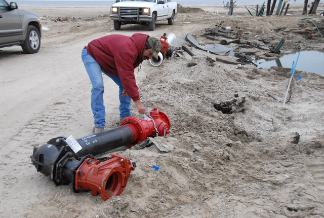 [Hurricane Rita] Holly Beach, LA, 1-27-06 -- Eric Miller from Johnson Bayou Water Works checks a new fire main to replace a damaged fire main from Hurricane Rita. FEMA is helping Local governments get Utilities back in operation under its Public Assistance program so residents can move back.  MARVIN NAUMAN/FEMA photo