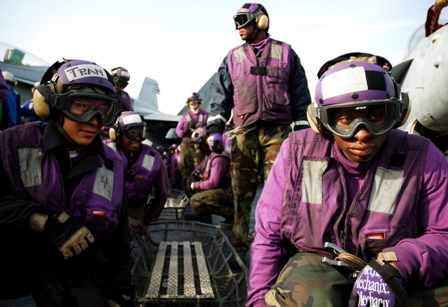 US Navy (USN) flight deck personnel participate in an aircraft fire drill on the flight deck of the USN Nimitz Class Aircraft Carrier USS THEODORE ROOSEVELT (CVN 71). The ROOSEVELT and its embarked Carrier Air Wing 8 (CVW-8) are underway in the Persian Gulf on a regularly scheduled deployment conducting maritime security operations