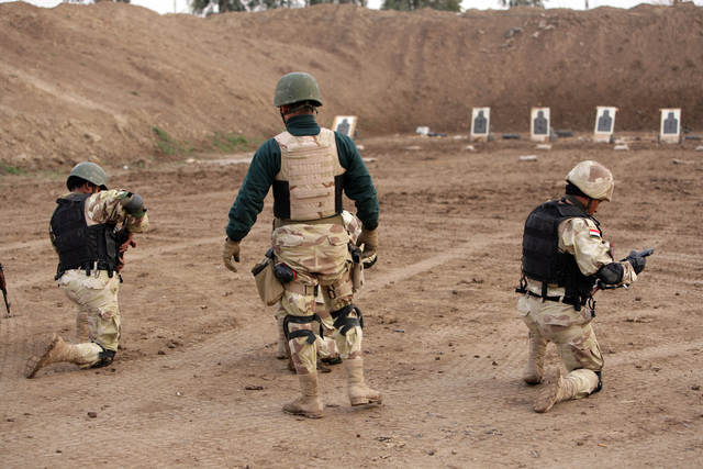 An Iraqi special operations instructor (pictured in green shirt) supervises a firing range for Iraqi special operations students as part of a training exercise Jan. 28, 2006, near Baghdad, Iraq.  With assistance from the Combined Joint Special Operations Task Force - Arabian Peninsula, the Iraqi Special Operations Forces Brigade has been increasingly taking the lead in conducting both training and real-world special operations throughout the country.  (U.S. Army photo by SPC. Earnest A. Christian) (RELEASED)