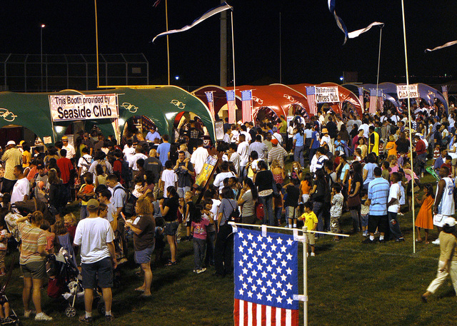 Crowds of visitors wait in line for food and drink during the 4th of July celebration aboard Commander Fleet Activities (CFA) Yokosuka Naval Base, Japan (JPN). Food tents were operated by on-base organizations such as Club Alliance, the Seaside Club and the Officer's Club