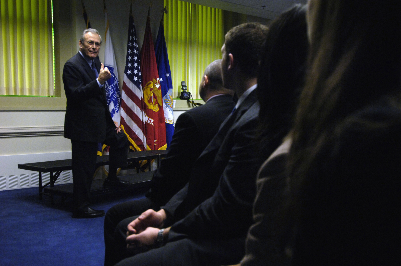 """The Honorable Donald H. Rumsfeld (left), U.S. Secretary of Defense (SECDEF), speaks to political science students from Whittier College, Calif., at the Pentagon, Washington, D.C., Jan. 30, 2006.  The students are on a weeklong visit to the area to culminate a course entitled,""""Nixon's Complex Legacy.""""The SECDEF gave his perspective from his time in the Nixon Administration as Director of Economic Opportunity and as the Chairman of the Gerald R. Ford Transition to Presidency in 1974.  (DoD photo by PETTY Officer 1ST Class Chad J. McNeeley) (Released)"""