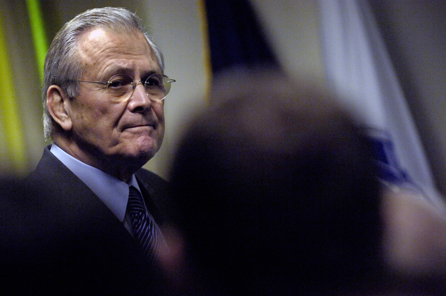 "The Honorable Donald H. Rumsfeld (left), U.S. Secretary of Defense (SECDEF), speaks to political science students from Whittier College, Calif., at the Pentagon, Washington, D.C., Jan. 30, 2006.  The students are on a weeklong visit to the area to culminate a course entitled,""Nixon's Complex Legacy.""The SECDEF gave his perspective from his time in the Nixon Administration as Director of Economic Opportunity and as the Chairman of the Gerald R. Ford Transition to Presidency in 1974.  (DoD photo by PETTY Officer 1ST Class Chad J. McNeeley) (Released)"