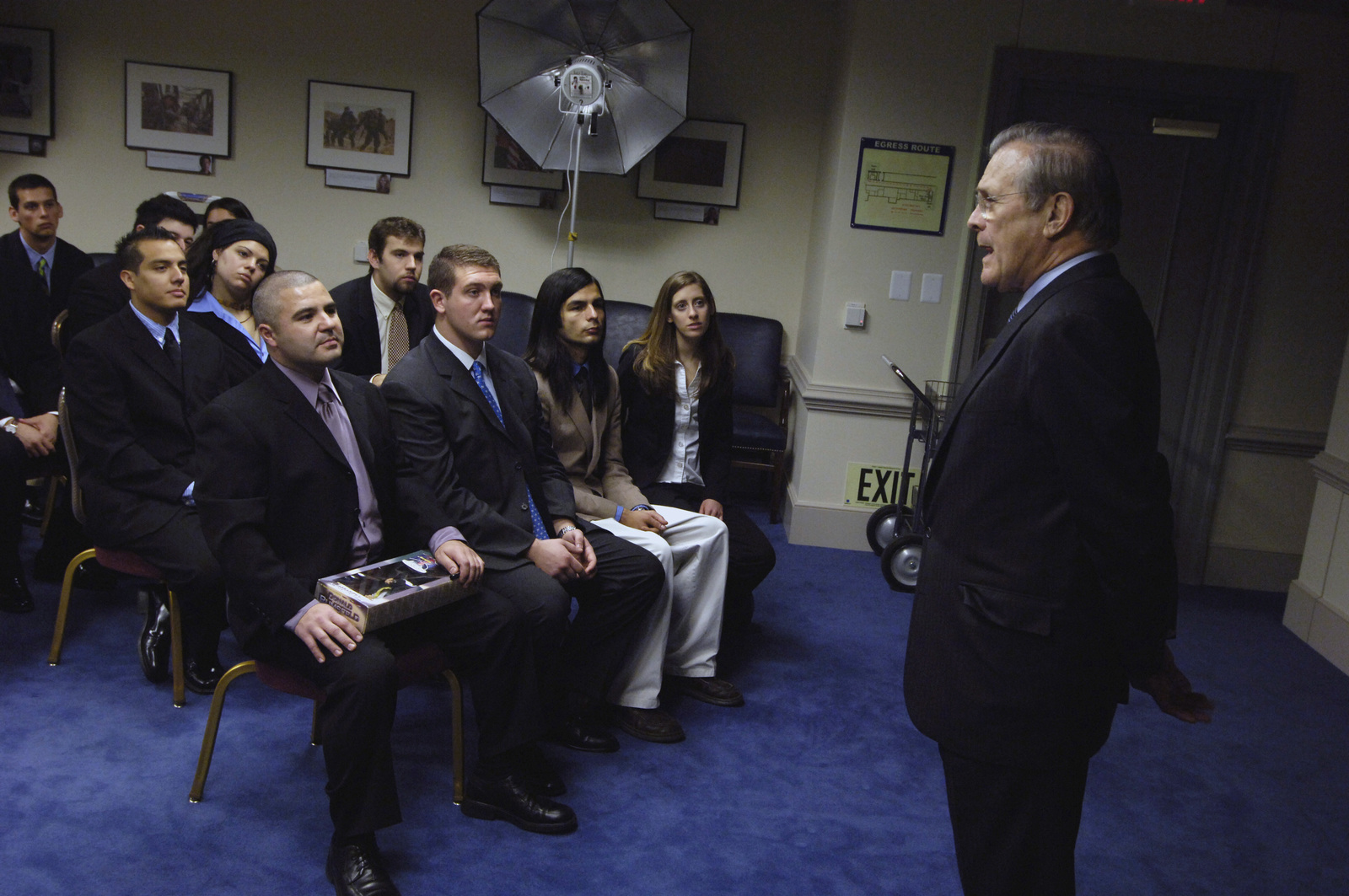 "The Honorable Donald H. Rumsfeld (right), U.S. Secretary of Defense (SECDEF), speaks to political science students from Whittier College, Calif., at the Pentagon, Washington, D.C., Jan. 30, 2006.  The students are on a weeklong visit to the area to culminate a course entitled,""Nixon's Complex Legacy.""The SECDEF gave his perspective from his time in the Nixon Administration as Director of Economic Opportunity and as the Chairman of the Gerald R. Ford Transition to Presidency in 1974.  (DoD photo by PETTY Officer 1ST Class Chad J. McNeeley) (Released)"