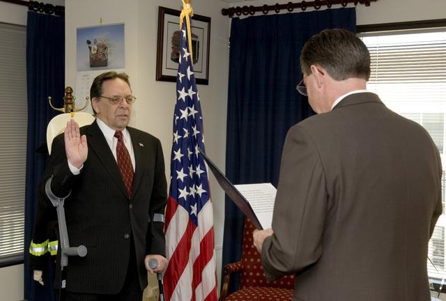 Washington, DC, January 30, 2006 -- Stephen Kempf being sworn in as the Regional Director of FEMA's Region II Office in New York City. Acting FEMA Director, R. David Paulison is administering the Oath of Office.  Bill Koplitz/FEMA