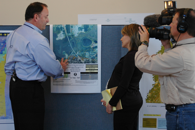 [Hurricane Katrina] Biloxi, MS, January 31, 2006 -- Nick Russo, FEMA Federal Coordinating Officer, briefs media on flood maps. Rebuilding efforts using these maps helps prevent damage in the event of a future hurricane. Leif Skoogfors/FEMA Photo