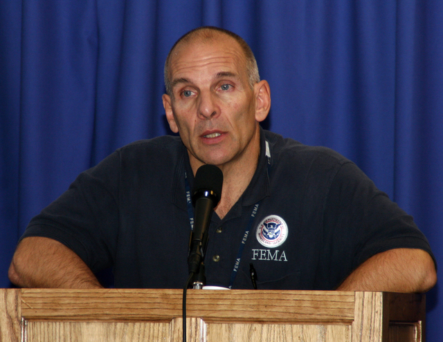[Hurricane Katrina] Baton Rouge, LA, February 3, 2006 - Scott Wells, FEMA Federal Coordinating Officer, speaks at Intergovernmental Affairs Day at the Joint Field Office in Baton Rouge.  Representatives from 18 parishes were in attendence.  Robert Kaufmann/FEMA