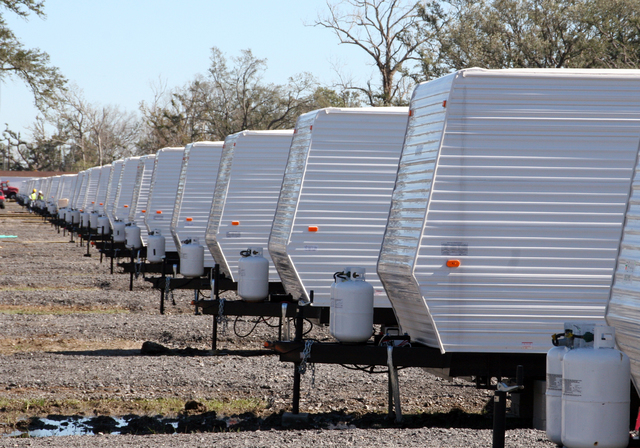 [Hurricane Katrina] Belle Chasse, LA, February 4, 2006 - Rows of FEMA provided travel trailers are installed in Plaquemines Parish for the temporary housing of the community's displaced residents.  Providing temporary housing in the disaster affected community enables the hurricane victims to be closer to home during the rebuilding process.  Robert Kaufmann/FEMA
