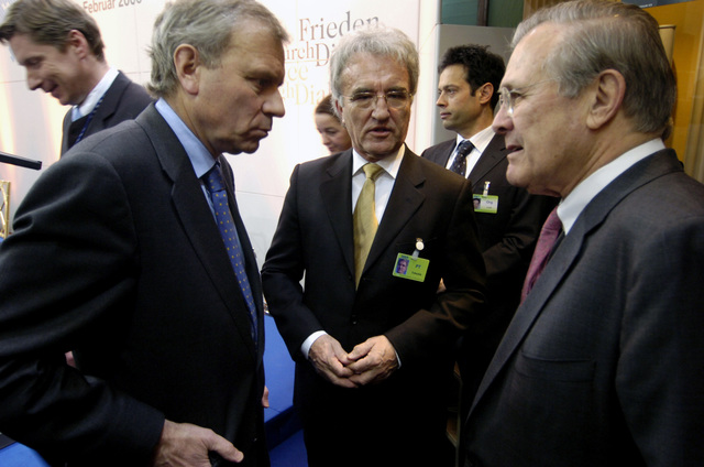 "The Honorable Donald H. Rumsfeld, U.S. Secretary of Defense, right, speaks with North Atlantic Treaty Organization (NATO) Secretary General Jaap de Hoop Schefferr, left, and Prof. Dr. H.C. Horst Teltschik, center, during the 42nd Munich Conference on Security Policy at Munich, Germany, on Feb. 4, 2006. The conference, which was attended by more than 250 participants from over 50 countries, was centered on the theme""Europe and the United States: The Renewal of Transatlantic Partnership.""(DoD photo by PETTY Officer 1ST Class Chad J. McNeeley) (Released)"