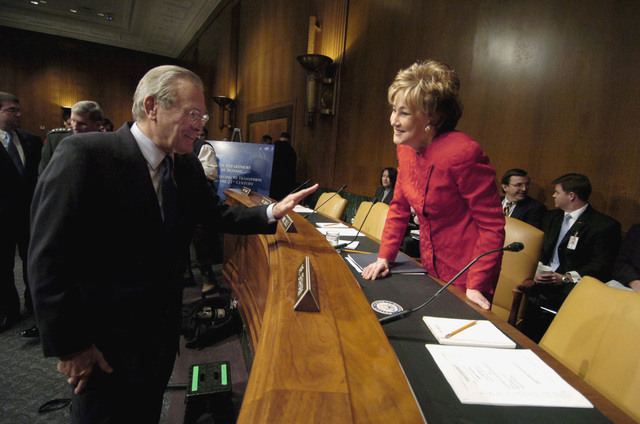 The Honorable Donald H. Rumsfeld, left, U.S. Secretary of Defense, greets U.S. Sen. Elizabeth Dole (R-N.C.) prior to his testimony before a Senate Armed Services Committee hearing at the Dirksen Senate Office Building in Washington, D.C., on Feb. 7, 2006. (DoD photo by PETTY Officer 1ST Class Chad J. McNeeley)  (Released)