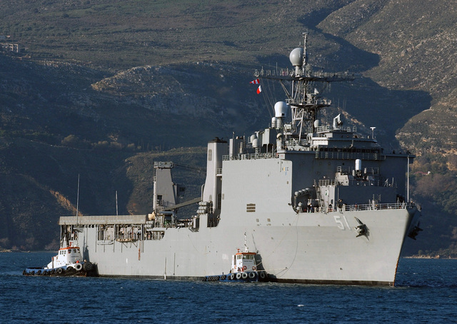 Starboard bow view of the US Navy (USN) Whidbey Island Class Dock Landing Ship, USS OAK HILL (LSD 51), being assisted by tugboats after arriving at Souda Bay, Crete, Greece, during a routine port visit with Amphibious Group 2 on a surge deployment in support of the global war on terrorism