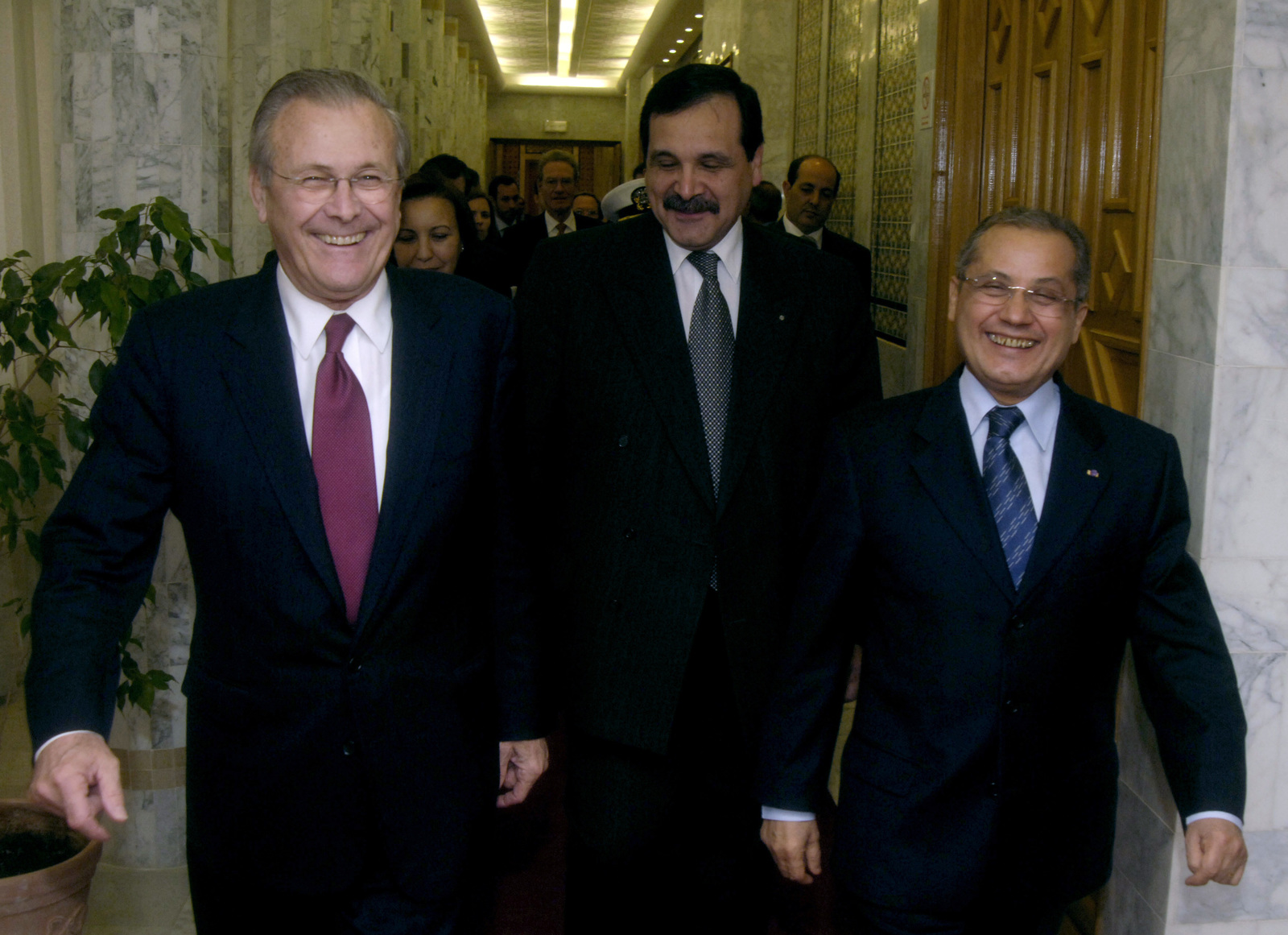 The Honorable Donald H. Rumsfeld, left, U.S. Secretary of Defense, and Tunisian Minister of Foreign Affairs Abdelwahab Abdallah are all smiles while on their way to a bilateral meeting in Tunis, Tunisia, on Feb 11, 2006. Sec. Rumsfeld is on a tour of numerous North African countries after attending the North Atlantic Treaty Organization (NATO) Defense Minister Meeting in Italy. (DoD photo by PETTY Officer 1ST Class Chad J. McNeeley) (Released)