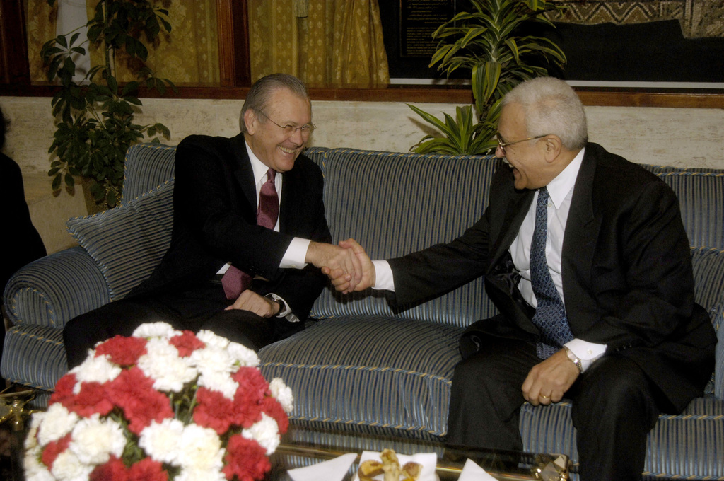 The Honorable Donald H. Rumsfeld, left, U.S. Secretary of Defense, shakes hands with Algerian Minister Delegate in Charge of National Defense Abdelmalek Guenaizia during a bilateral meeting in Algiers, Algeria on Feb. 12, 2006. Sec. Rumsfeld is on a tour of numerous North African countries after attending the North Atlantic Treaty Organization (NATO) Defense Minister Meeting in Italy. (DoD photo by PETTY Officer 1ST Class Chad J. McNeeley) (Released)