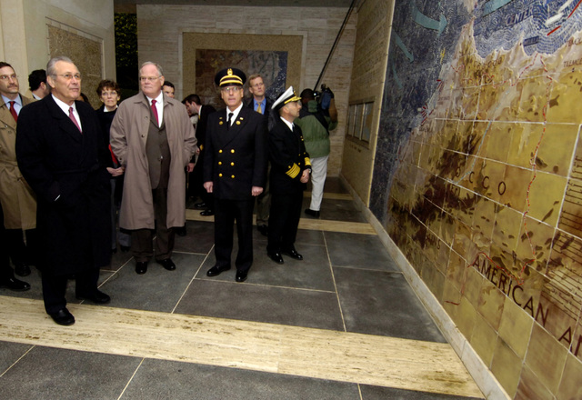 The Honorable Donald H. Rumsfeld, left, U.S. Secretary of Defense, tours the North African American Cemetery and Memorial during his visit in Tunis, Tunisia on Feb. 12, 2006. There are 2,841 U.S. military buried at this 27-acre site north of Tunis. The memorial was completed in 1960 in memory of the U.S. service members who gave their lives in the liberation of Tunisia during World War II. (DoD photo by PETTY Officer 1ST Class Chad J. McNeeley) (Released)