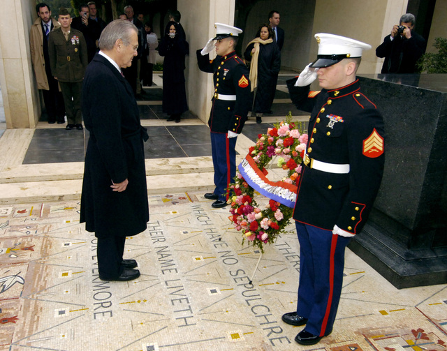 The Honorable Donald H. Rumsfeld, U.S. Secretary of Defense, lays a wreath in the Court of Honor at the North African American Cemetery and Memorial during his visit in Tunis, Tunisia on Feb. 12, 2006. There are 2,841 U.S. military buried at this 27-acre site north of Tunis. The memorial was completed in 1960 in memory of the U.S. service members who gave their lives in the liberation of Tunisia during World War II. (DoD photo by PETTY Officer 1ST Class Chad J. McNeeley) (Released)