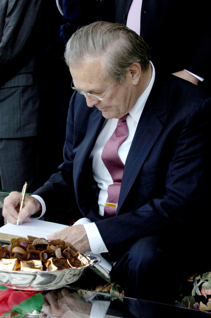 The Honorable Donald H. Rumsfeld, U.S. Secretary of Defense, signs a guest book during a tour of the Royal Arabian Horse Stud Farm of Bouznika during his visit in Rabat, Morocco, on Feb 12, 2006. Sec. Rumsfeld is on a tour of numerous North African countries after attending the North Atlantic Treaty Organization (NATO) Defense Minister Meeting in Italy. (DoD photo by PETTY Officer 1ST Class Chad J. McNeeley) (Released)