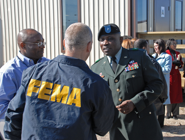 [Hurricane Katrina] New Orleans, LA, 2-13-06 -- FEMA Federal Coordinating Officer Scott Wells and Brigadier General Robert Crear Commander of U.S. Army Corps of Engineers, who is in charge of the construction at Southern University at New Orleans campus, great each other at the Grand Opening Ribbon cutting of the Facility FEMA is providing for them.  FEMA is providing the Southern University at New Orleans (SUNO) with 45 Modular Buildings to provide instructional Classrooms, Offices, Cafeteria, and facilities staffed for student education and FEMA Travel Trailers to house students and staff.  Southern University at New Orleans (SUNO) is the only School Campus in the United States to be built