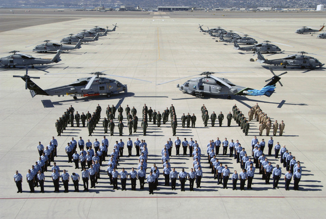 US Navy (USN) Helicopter Maritime Strike Squadron Four One (HSM-41, Seahawks) Sailors, Naval Air Station (NAS) North Island (NI), San Diego, California (CA), stand in a special formation to commemorate over 130,000 Class A mishap free hours, which means no total cost of reportable material property damage of $1 million or more, no injury or occupational illness resulting in a fatality, or no permanent and total disability