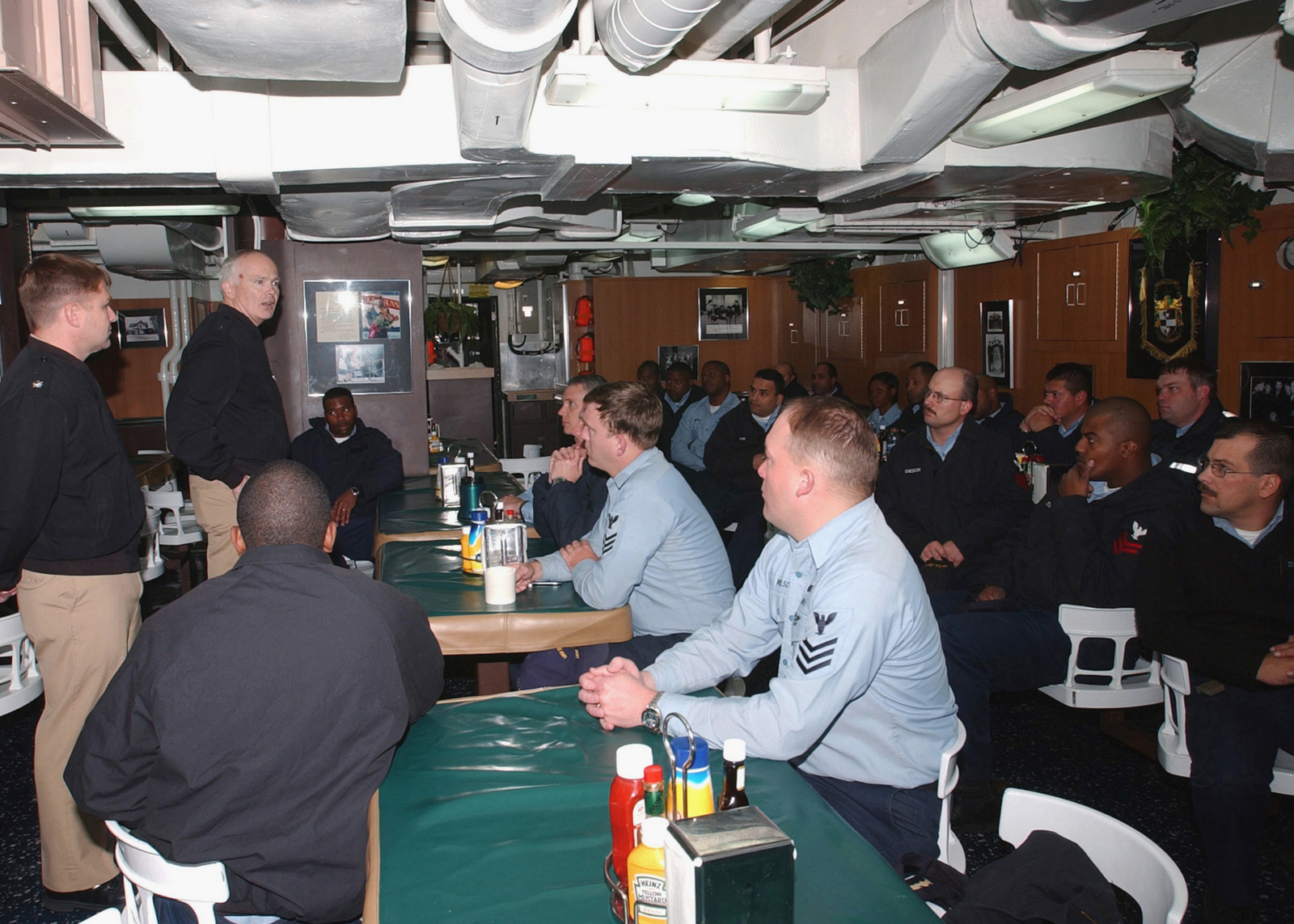 US Navy (USN) Rear Admiral (RADM) Richard O'Hanlon (standing background left), Commander, Strike Force Training Atlantic (STRKFORTRALANT), speaks with a group of PETTY Officer First Class (PO1) Sailors about fleet shipboard changes and issues that affect the crew, during his visit aboard the USN Ticonderoga Class (Flight II): Guided Missile Destroyer (Aegis), USS SULLIVANS (DDG 68)