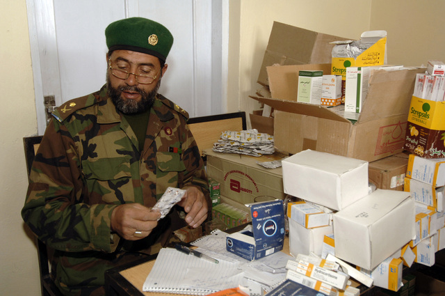 An ANA (Afghan National Army) Medic reads over a Doctor's prescription during a MEDCAP (Medical Operation) at the Shahed Sayed Padsha School, Kandahar City, Afghanistan, 15 February 2006. (U.S. Army PHOTO by SPC. Leslie Angulo) (Released)