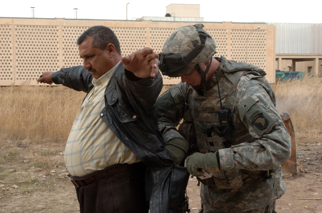 On February 15, 2006 soldiers from B Company, 2-506 INF (Band of Brothers) conducted a search operation of a local meat packing slaughter house near Observation Post Red in Southern Baghdad. The area was known for having ties to Anti Iraqi Forces. PFC Clifton from B Co 2nd Platoon searched a man as a safety measure during the search.(Released)US Army photo by SSG Kevin L. Moses Sr