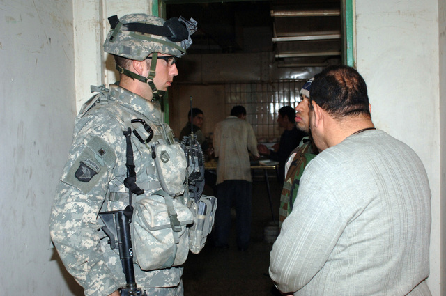 On February 15, 2006 soldiers from B Company, 2-506 INF (Band of Brothers) conducted a search operation of a local meat packing slaughter house near Observation Post Red in Southern Baghdad. The area was known for having ties to Anti Iraqi Forces. 1LT Joshua Headley from B Co 2nd Platoon questioned the manager of the slaughter house.(Released)US Army photo by SSG Kevin L. Moses Sr