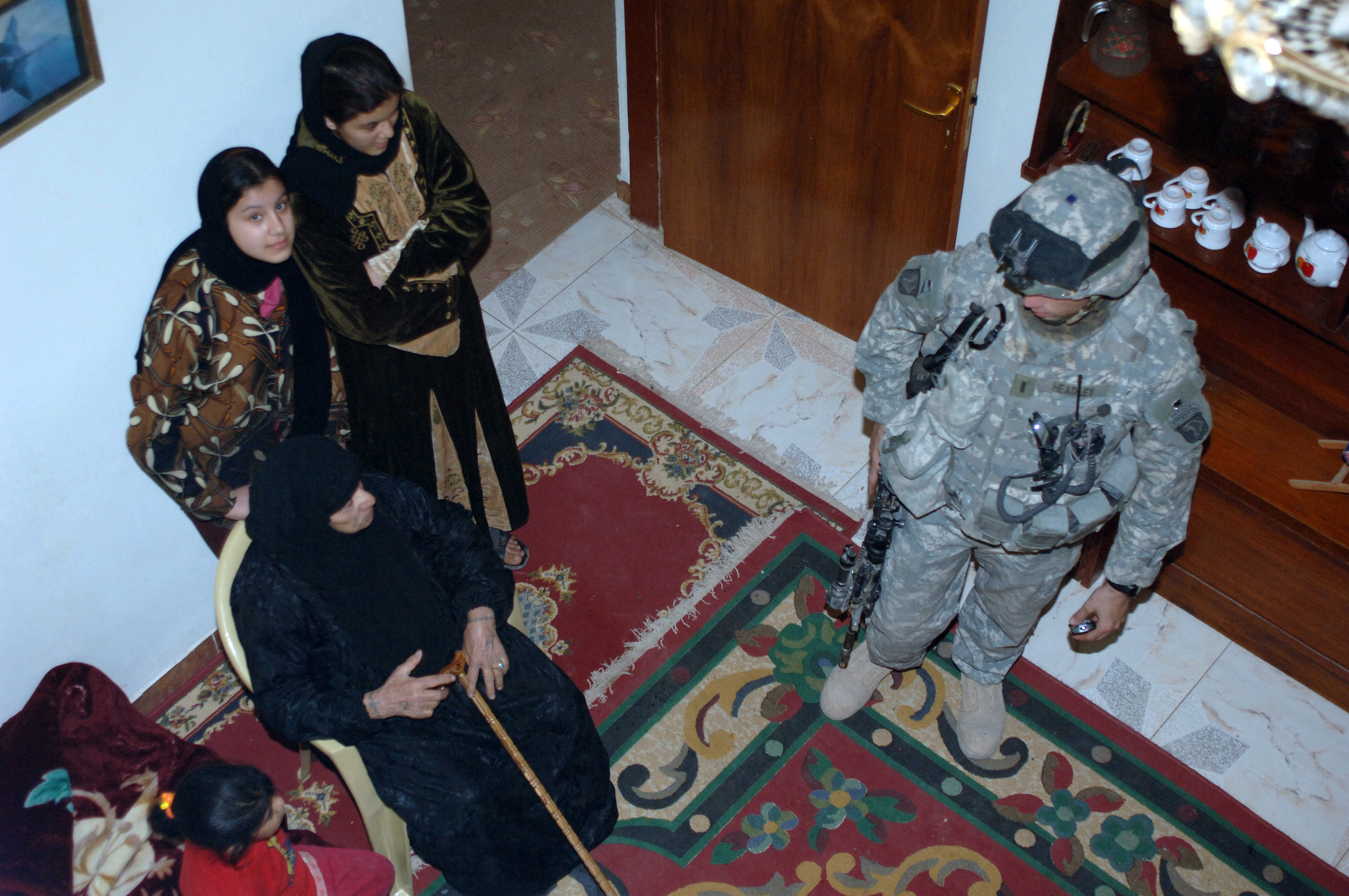 On February 15, 2006 soldiers from B Company, 2-506 INF (Band of Brothers) conducted a search operation of a local meat packing slaughter house near Observation Post Red in Southern Baghdad. The area was known for having ties to Anti Iraqi Forces. 1LT Joshua Headley from B Co 2nd Platoon questioned a family that lived near the meat packing house.(Released)US Army photo by SSG Kevin L. Moses Sr
