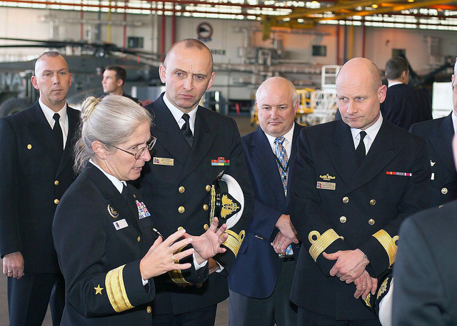 The US Navy (USN) Commander of the Mine Warfare Command, Rear Admiral (RDML) (lower half) Deborah Loewer, briefs the CHIEF of STAFF (CS) of the Royal Norwegian Navy (RNN) Rear Admiral (RADM) Jan Eirik Finseth and Commander of the Norwegian Fleet, Commodore (CMDR) Haakon Tronstad during their visit to Helicopter Mine Countermeasures Squadron 15 (HM-15) at Naval Air Station (NAS) Corpus Christi, Texas (TX)