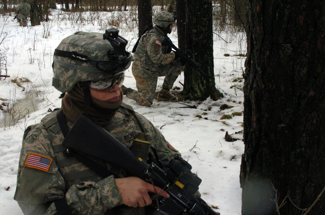 PFC Henry Rochez a Rifleman with Charlie Company, TF 1-26, 2BCT, 1ID, pulls security while his team gets in position during a Platoon Live Fire Exercise in Grafenwoehr, Germany on February 17, 2006. (US Army photo by PFC Ethan Anderson) (RELEASED)