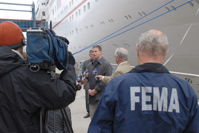 [Hurricane Katrina] New Orleans, St. Bernard, LA, 02-19-06 -- FEMA Deputy Federal Coordinating Officer Tony Robinson talks to Media in front of the Cruse ship Ecstasy about issues and scope of private meetings with victims living on the cruse ships Ecstasy and Sensation to be held starting Monday.  FEMA is helping Victims living on the Cruse ships find long term housing needs before the Ships contract expires March 1st and the ship sets sail.  MARVIN NAUMAN/FEMA photo