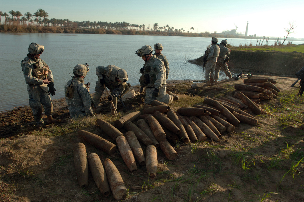 On 19 February 2006 soldiers from 10th Mountain, 2nd Battalion, 22nd Infantry conducted Operation Vigilant Warrior in the Village of Oswesat on the Euphrates River. The purpose of the Air Assault Operation was to capture suspected terrorist and capture and destroy large caches of ordnance to deter terrorist from conducting a planned raid on the Abu Ghraib Prison. Soldiers form 2-22 INF dug a cache site full of 105-155mm rounds found buried on the edge of the Euphrates River. The site held around 80 rounds in it.(Released)US Army photo by SSG Kevin L. Moses Sr