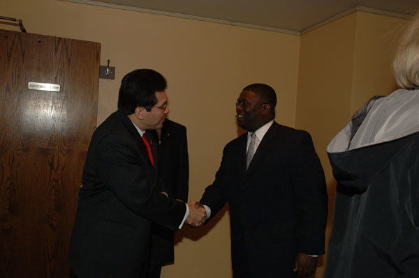 U.S. Attorney General Alberto Gonzales, left, greeting the Reverend Arthur Price, Jr., Pastor of the Sixteenth Street Baptist Church, Birmingham, Alabama, at events marking the designation of the Church, famous civil rights movement meeting place and site of 1963 bombing, as a National Historic Landmark