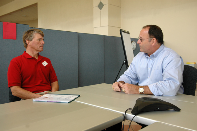 [Hurricane Katrina] Biloxi, Miss., February 22, 2006 -- Congressman Gene Taylor (left) discusses the recovery efforts in Mississippi with FEMA Federal Coordinating Officer (FCO) Nick Russo.  Congressman Taylor stopped by the Joint Field Office (JFO) in Biloxi to thank FEMA employees for their work in the state.  Mark Wolfe/FEMA