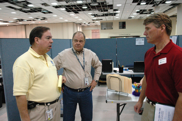 [Hurricane Katrina] Biloxi, Miss., February 22, 2006 --  FEMA Deputy Federal Coordinating Officer (DFCO) Jesse Munoz (left) and Human Services Branch Director Bob Weber speak with Congressman Gene Taylor at the Joint Field Office (JFO) in Biloxi.  Rep. Taylor is checking on the status of the recovery efforts in Mississippi.  Mark Wolfe/FEMA