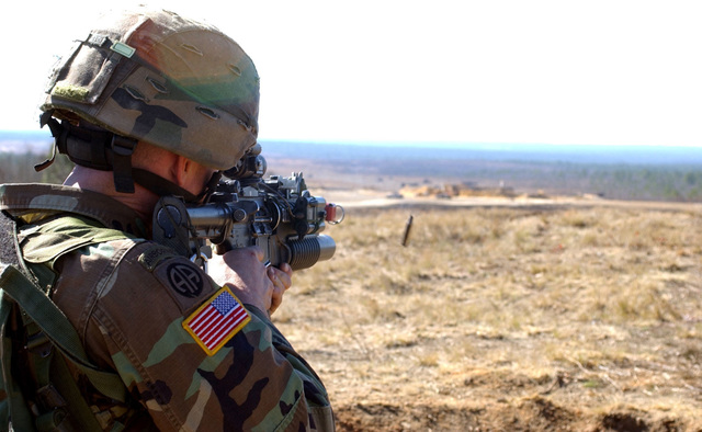 U.S. Army PFC. Chris McFarland, an infantryman with Delta Company, 1ST Battalion, 505th Parachute Infantry Regiment, 82nd Airborne Division, provides cover fire for a squad assaulting a mock city at Observation Post 13, Fort Bragg, N.C., Feb. 22, 2006.  (U.S. Army photo by PFC. Joshua R. Ford) (Released)