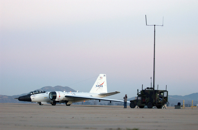 A National Air and Space Agency (NASA) WB-57 Camberra aircraft loaded with a Battlefield Airborne Communications Node (BACN), communicates with the US Joint Forces Command's (USJFCOM) Rapid Attack Information Dissemination-Execution Relay mobile vehicle (RAIDER) at US Marine Corps (USMC) Air Station (AS) Miramar, California (CA)