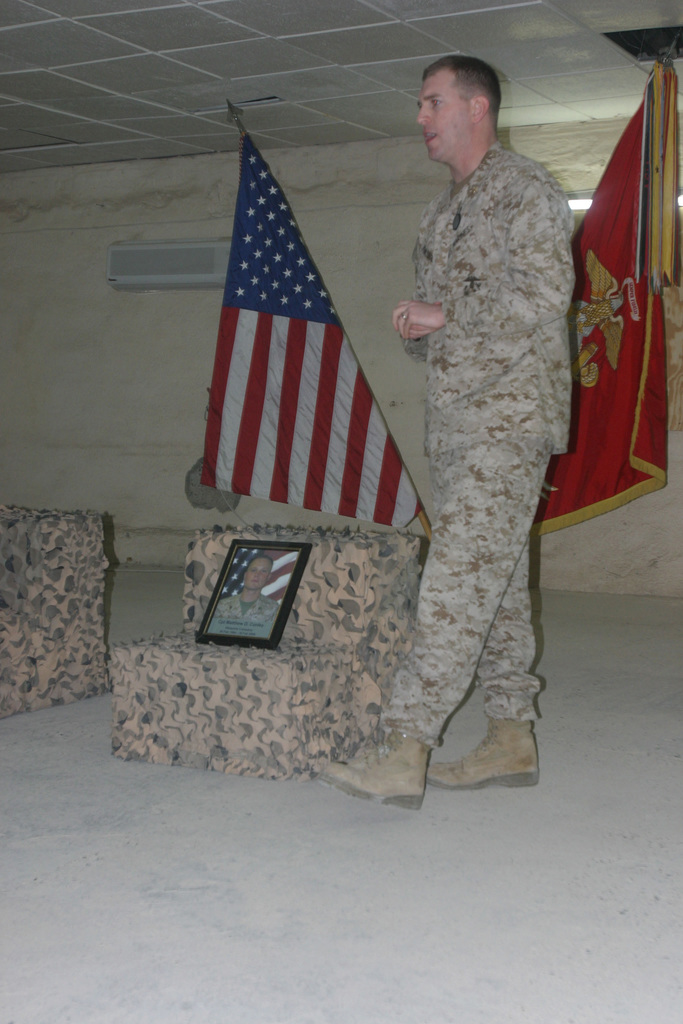 U.S. Marine Corps MAJ. Powledge, Weapons Company Commander, 3rd Battalion 7th Marine Regiment, gives his remarks at the Memorial Ceremony for 2nd LT. Almar L. Fitzgerald and CPL. Matthew D. Conley at Hurricane Point. The Marines of 2d Marine Division conduct counter-insurgency operations to isolate and neutralize Anti Iraqi Forces; support development of Iraqi Army (IA); support Iraqi reconstruction and democratic elections; and to facilitate the creation of secure environment that enables Iraqi self reliance and self government. (U.S. Marine Corps photo by CPL. Thomas D. Hudzinski) (Released)