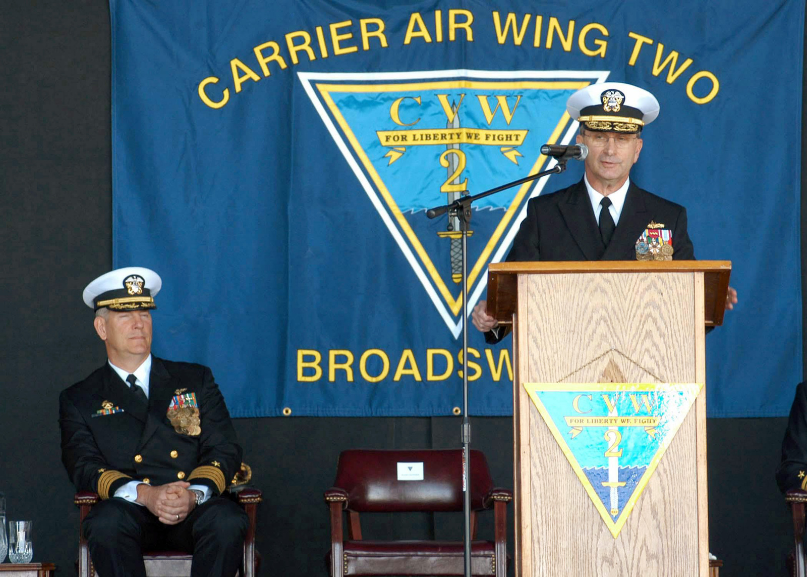 US Navy (USN) Assist Deputy of Naval Operations for Information, Plans and Strategy (NOIPS) Rear Admiral (RADM) William D. Crowder, speaks during Carrier Air Wing 2 (CVW-2) change of command ceremony at Naval Air Station (NAS) Lemoore, California (CA)