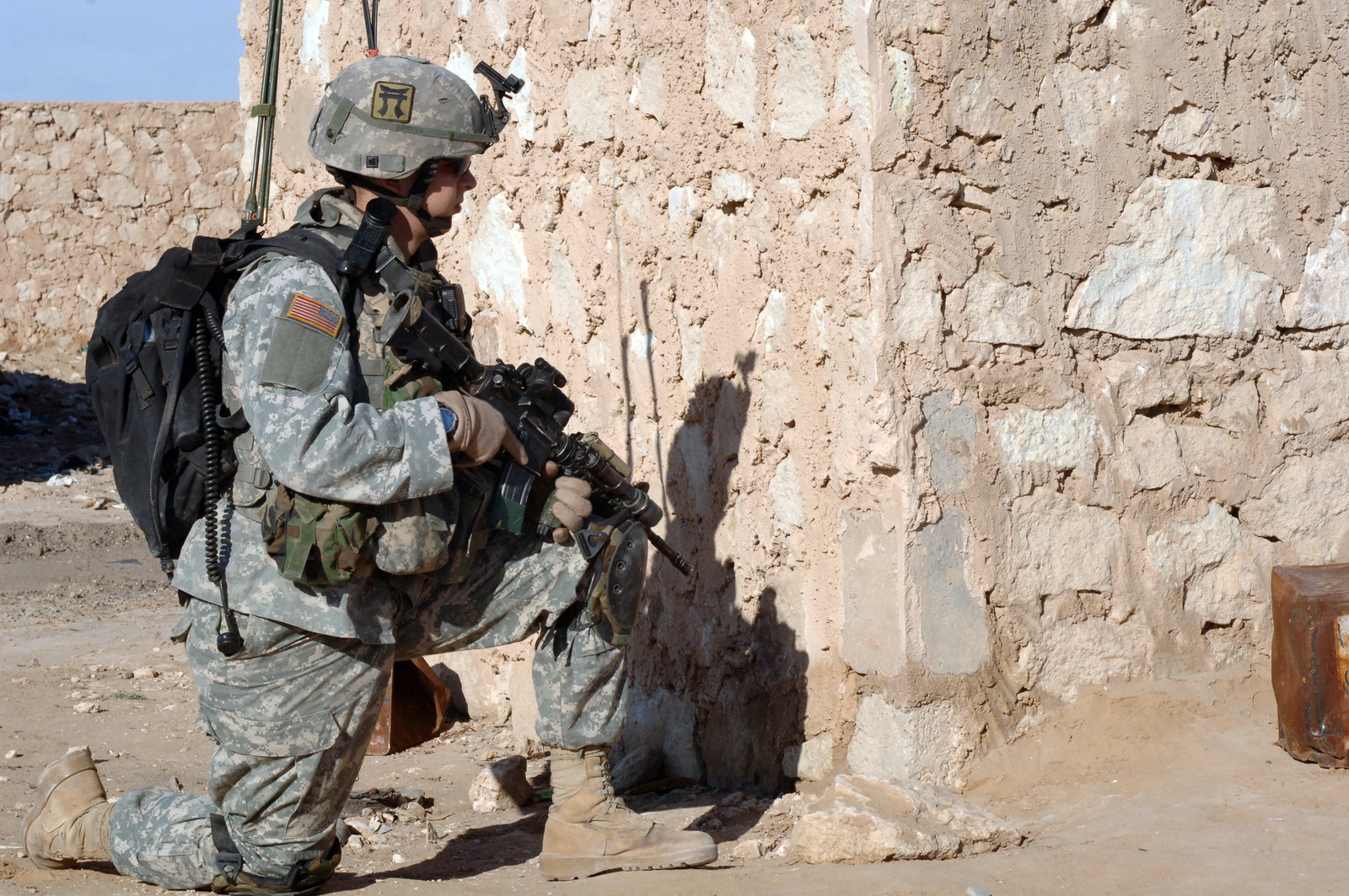 A Soldier Of 1ST Platoon C Company Battalion 187th Infantry Regiment 101st Airbourne Division Takes Knee To Provide Security During Dismounted