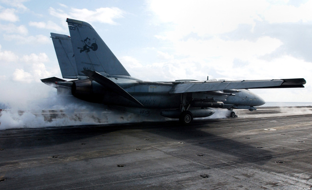 """A US Navy (USN) F-14D Tomcat aircraft assigned to the """"Tomcatters"""" of Fighter Squadron 31 (VF-31) launches from the flight deck of the USN Nimitz Class Aircraft Carrier, USS THEODORE ROOSEVELT (CVN 71), while the ship and embarked Carrier Air Wing 8 (CVW-8) are underway in the Mediterranean Sea during a regularly scheduled deployment conducting Maritime Security Operations (MOS)"""