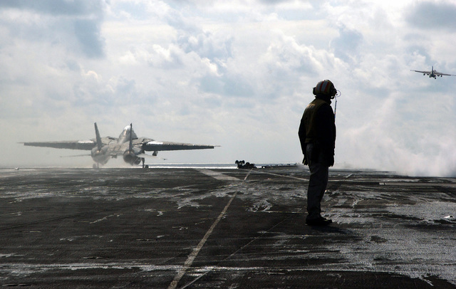 US Navy (USN) Flight Deck Officer, Lieutenant (LT) Jeff Sandin looks on after the launch of an F-14D Tomcat aircraft and an S-3B Viking aircraft, from the flight deck of the USN Nimitz Class Aircraft Carrier, USS THEODORE ROOSEVELT (CVN 71). The ROOSEVELT and embarked Carrier Air Wing 8 (CVW-8) are currently on a regularly scheduled deployment conducting maritime security operations in the Mediterranean Sea