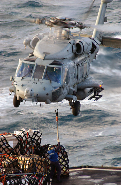 "A US Navy (USN) HH-60 Seahawk helicopter assigned to the ""Tridents"" of Anti-Submarine Squadron 3 (HS-3) transfers stores during a Vertical Replenishment (VERTREP) exercise between the US Navy (USN) Military Sealift Command (MSC) Sirius (Lyness) Class Combat Stores Ship USNS SPICA (T-AFS 9) (shown here) and USN Nimitz Class Aircraft Carrier USS THEODORE ROOSEVELT (CVN 71) (not shown). The ROOSEVELT and embarked Carrier Air Wing 8 (CVW-8) are currently on a regularly scheduled deployment conducting maritime security operations, while underway in the Mediterranean Sea"