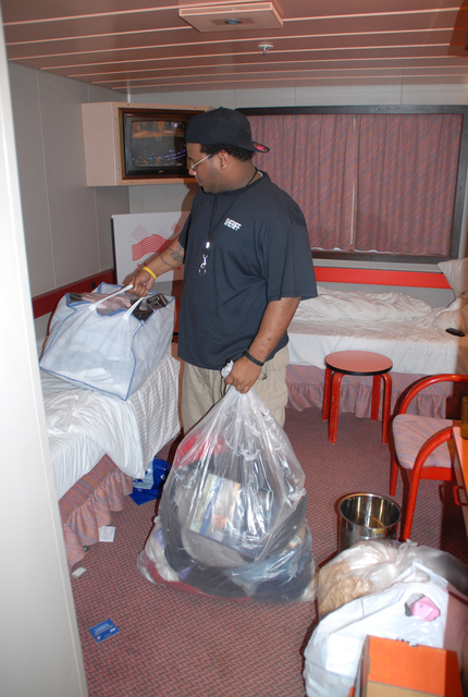 """[Hurricane Katrina] New Orleans, St. Bernard, LA, 03-1-06 -- Orleans Sheriff Martin Blossom Jr. prepares to leave his room on the cruise ship """"Sensation"""" and move into a 29 unit FEMA Trailer park.  The the cruise ship housed city workers.  Marvin Nauman/FEMA photo"""